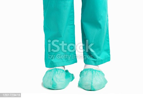 Cropped shot of a doctor man and hygienic shoe cover for feet with white background