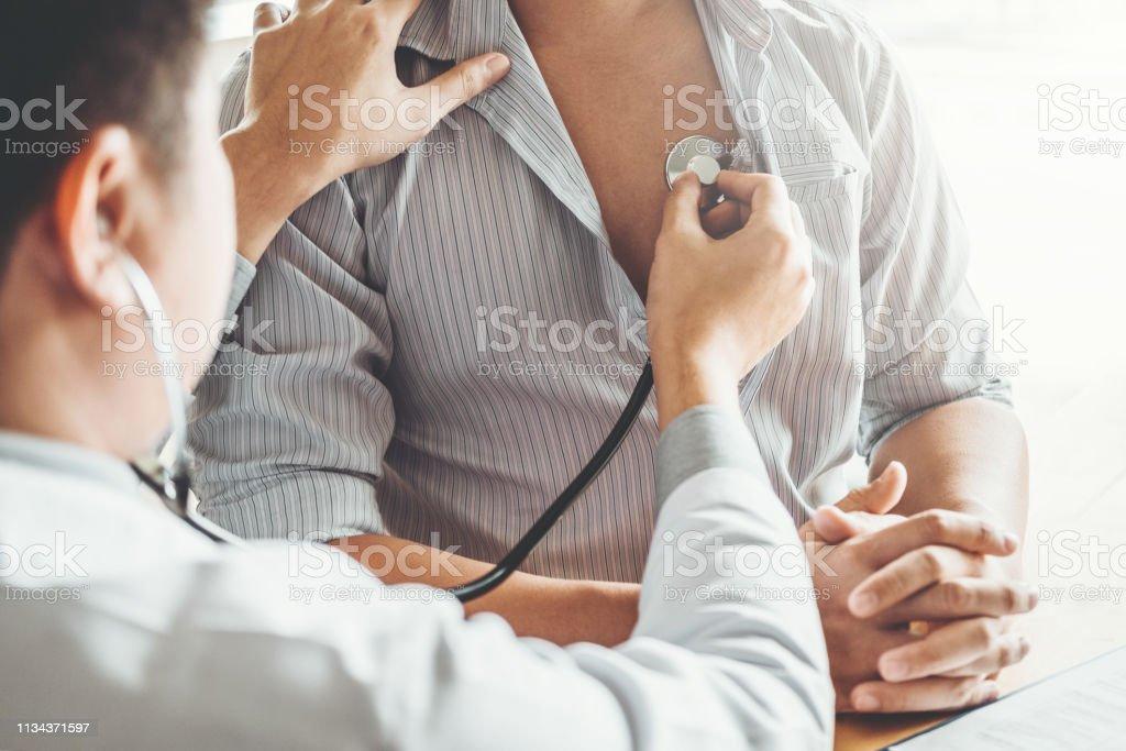 Doctor Measuring arterial blood pressure man patient Health care in...