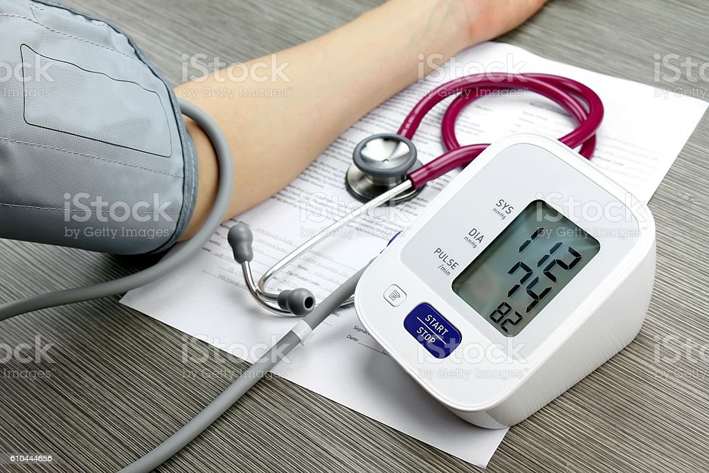 Doctor measuring blood pressure of patient, Digital Blood Pressure Monitor stock photo