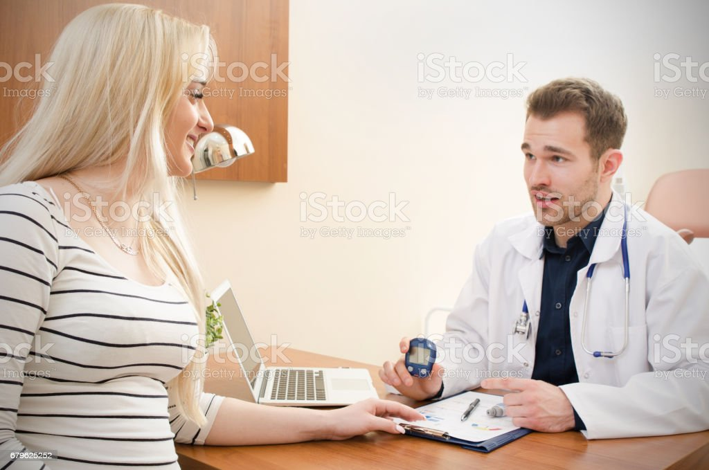 Doctor measuring of blood sugar for diabetes patient stock photo