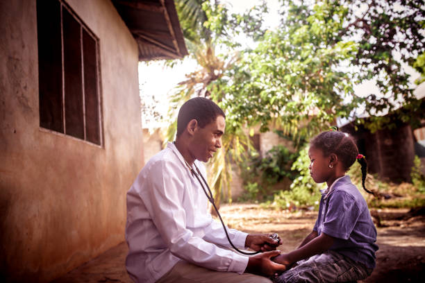 Doctor meet African child Doctor meet African child east africa stock pictures, royalty-free photos & images