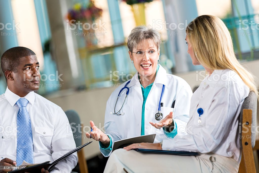 Doctor meet with hospital administrators stock photo