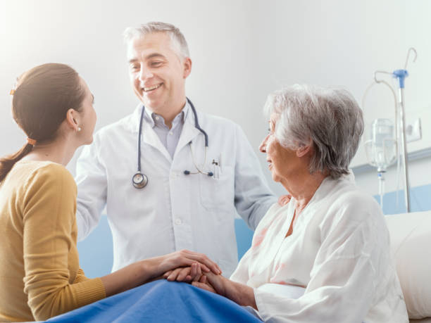 Doctor meeting a senior patient and her daughter