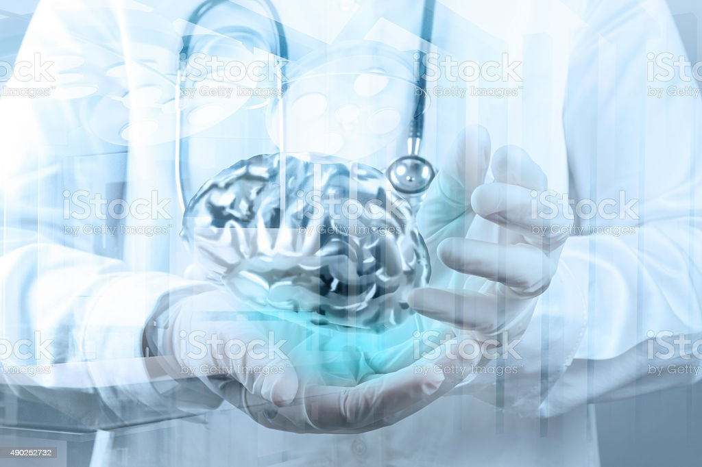 doctor neurologist hand show metal brain stock photo