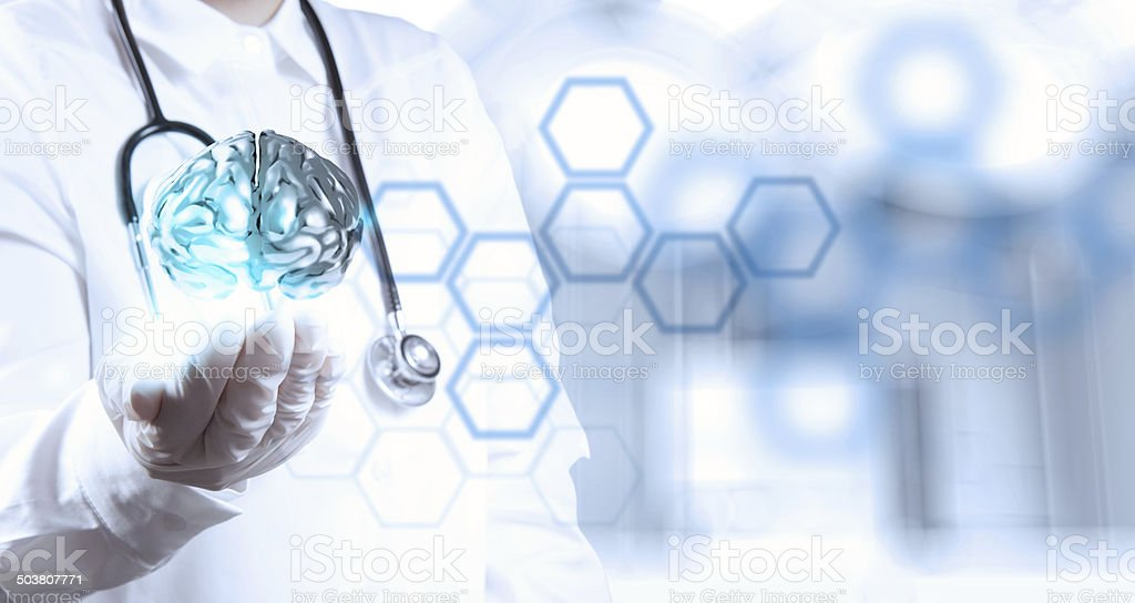 doctor neurologist hand show metal brain with computer interface stock photo