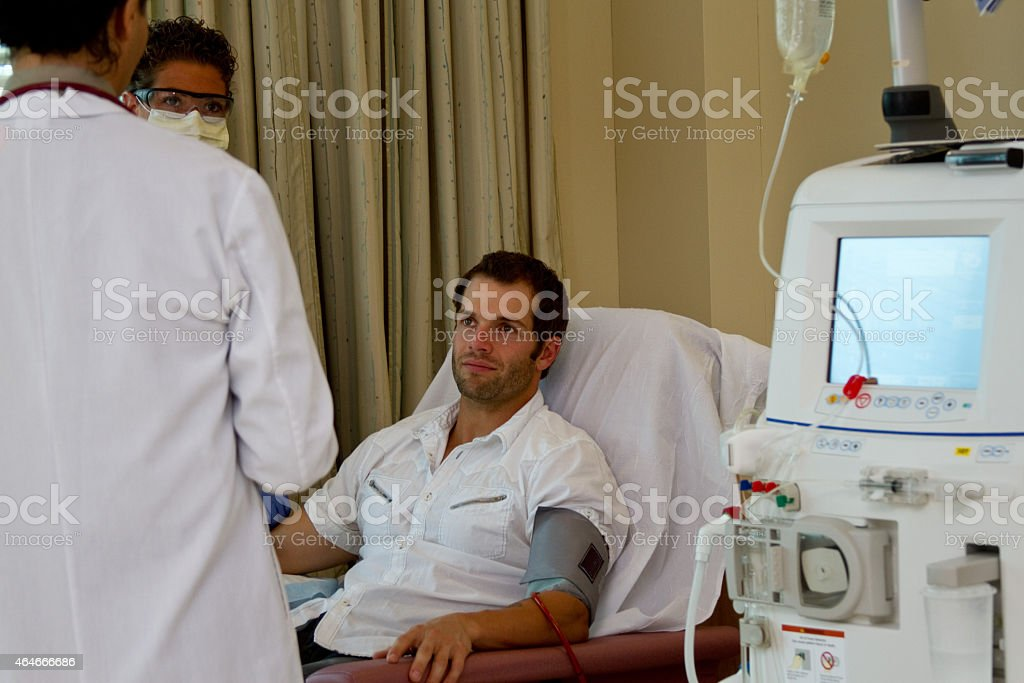 Doctor, nurse and patient reviewing care Renal dialysis patient has care review with doctor and nurse 2015 Stock Photo