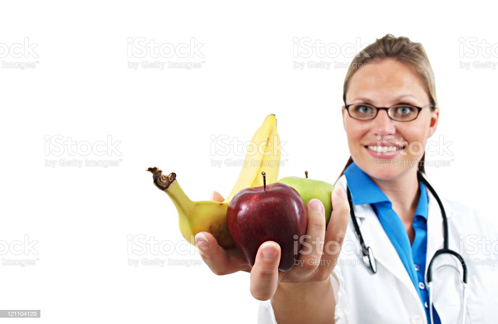 Doctor Nutritionist with Fruit royalty-free stock photo