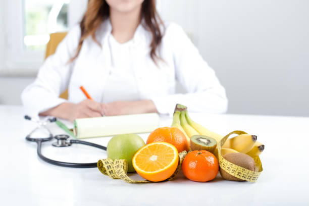Doctor nutritionist with fruits and vegetable stock photo