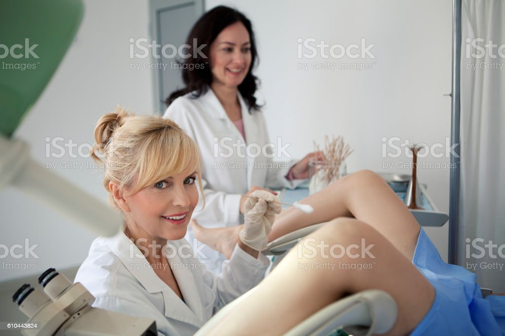 Doctor obtaining a cervical smear stock photo