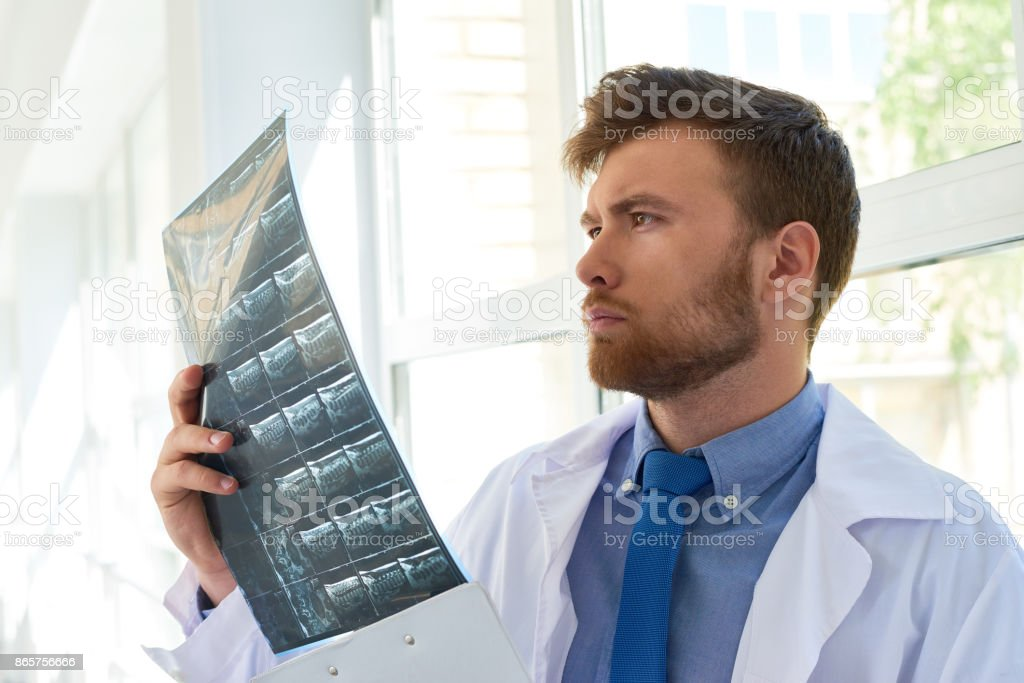 Doctor Of Osteopathic Medicine Viewing Xray Image Stock