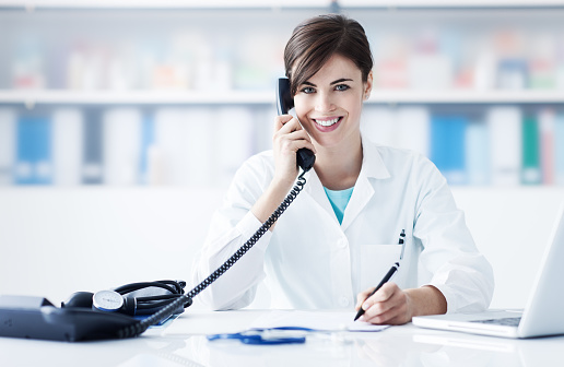 istock Doctor on the phone 907614848