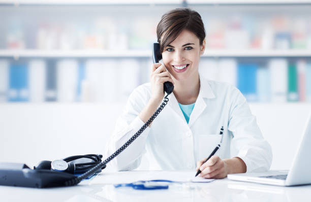 doctor on the phone - nurse on phone stock photos and pictures