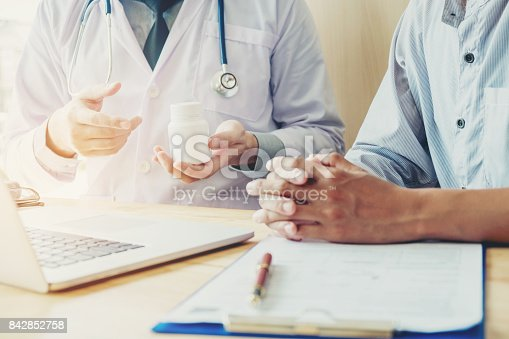 istock Doctor or physician recommend pills  medical prescription to male Patient Doctor or physician recommend pills  medical prescription to male Patient 842852758