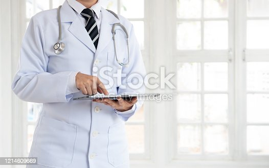 845455852 istock photo Doctor or physician using digital tablet 1214609669
