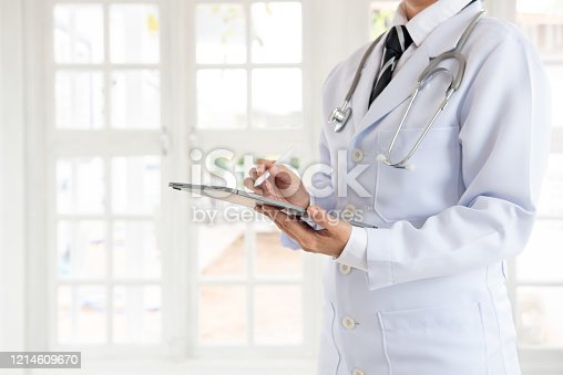 845455852 istock photo Doctor or physician using digital tablet 1214609670