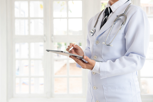 927897070 istock photo Doctor or physician using digital tablet 1214609670