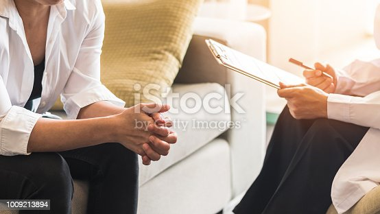 istock Doctor or psychiatrist consulting and diagnostic examining stressful woman patient on obstetric - gynecological female illness, or mental health in medical clinic or hospital healthcare service center 1009213894