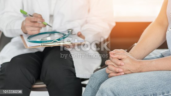 964904920 istock photo Doctor or psychiatrist consulting and diagnostic examining stressful woman patient on obstetric - gynecological female illness, or mental health in medical clinic or hospital healthcare service center 1012230236
