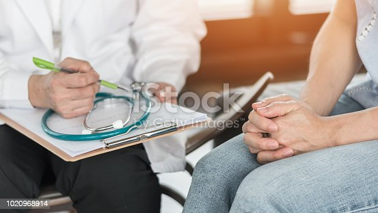 istock Doctor or psychiatrist consulting and diagnostic examining stressful woman patient on obstetric - gynecological female illness, or mental health in medical clinic or hospital healthcare service center 1020968914