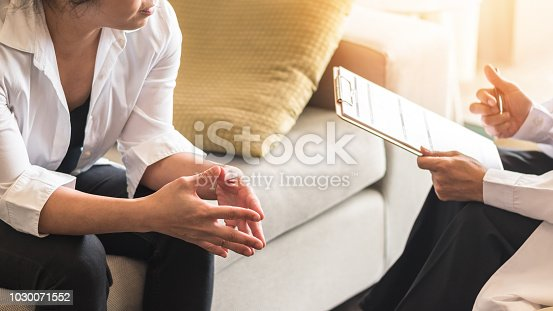istock Doctor or psychiatrist consulting and diagnostic examining stressful woman patient on obstetric - gynecological female illness, or mental health in medical clinic or hospital healthcare service center 1030071552
