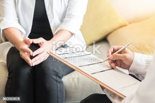 964904920 istock photo Doctor or psychiatrist consulting and diagnostic examining stressful woman patient on obstetric - gynecological female illness, or mental health in medical clinic or hospital healthcare service center 960563828