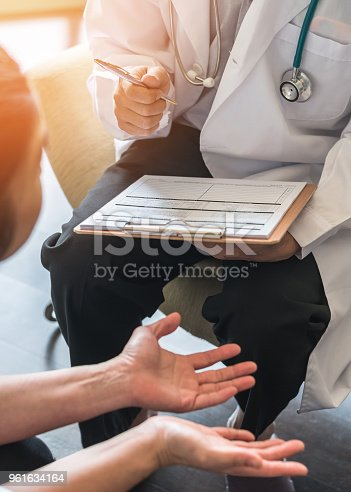 964904920 istock photo Doctor or psychiatrist consulting and diagnostic examining stressful woman patient on obstetric - gynecological female illness, or mental health problem in medical clinic or hospital 961634164