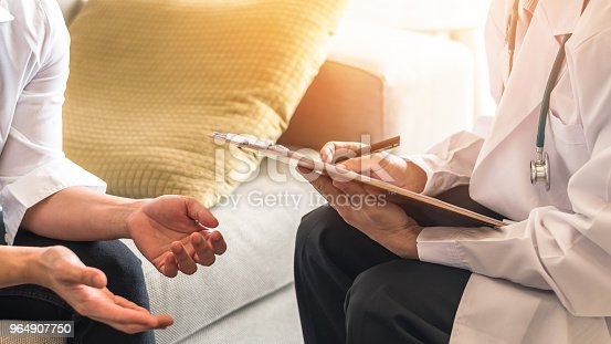 964904920 istock photo Doctor or psychiatrist consulting and diagnostic examining stressful woman patient on obstetric - gynecological female illness, or mental health in medical clinic or hospital healthcare service center 964907750