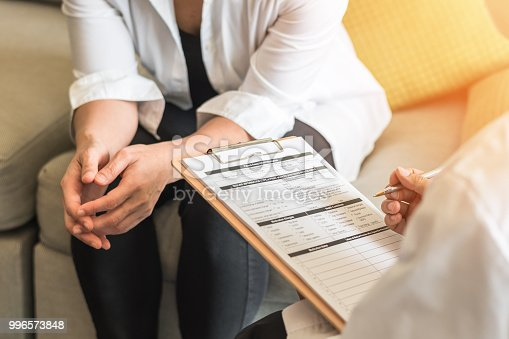 964904920 istock photo Doctor or psychiatrist consulting and diagnostic examining stressful woman patient on obstetric - gynecological female illness, or mental health in medical clinic or hospital healthcare service center 996573848