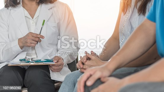 istock Doctor or psychologist with patient couple consulting on marriage counseling, family medical healthcare therapy, fertility treatment for infertility, or psychotherapy session concept 1021950250