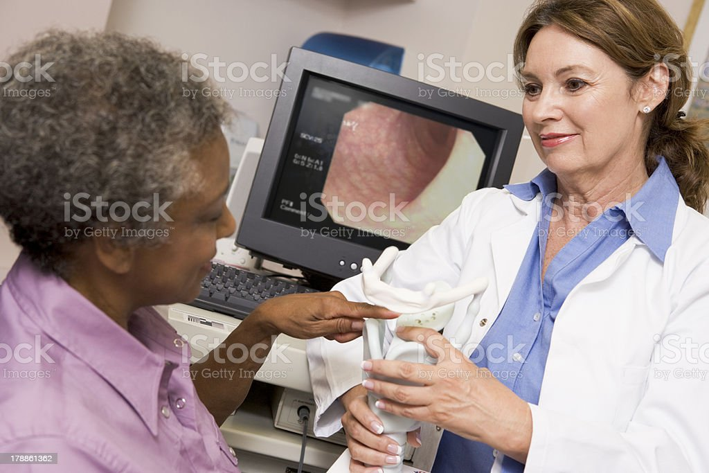 Doctor Performing Check-Up On Patient stock photo