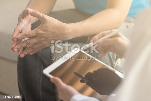 965324772 istock photo Doctor physician consulting with male patients in hospital exam room. Men's health concept 1170710354