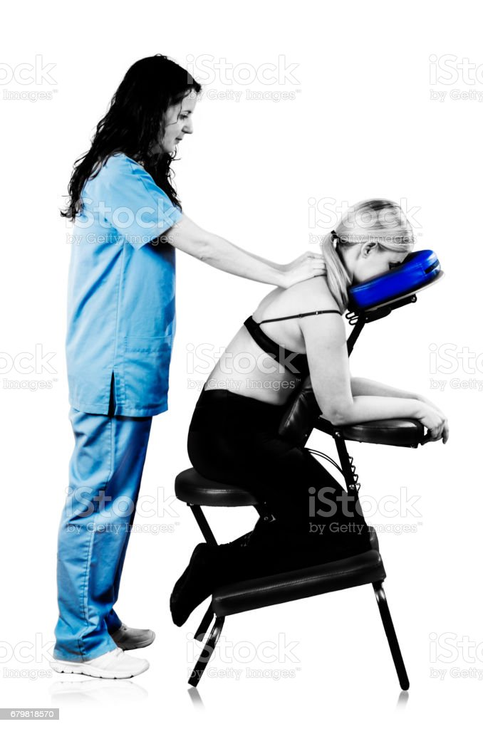 Doctor, physiotherapist examining her patient back and doing decontracting massage in silhouette studio on white background. stock photo