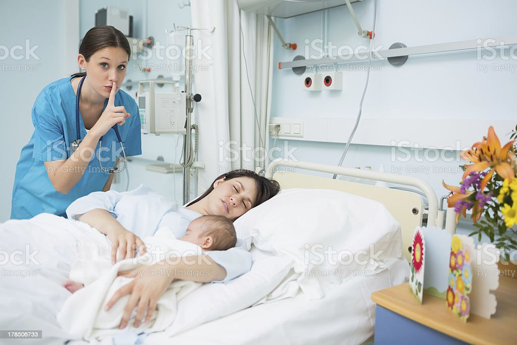 Doctor placing finger on her mouth royalty-free stock photo