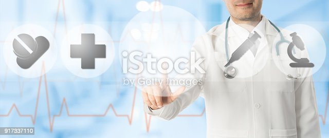 688358418istockphoto Doctor Points at Copy Space with Medical Icons 917337110