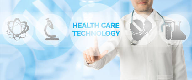 Doctor Points at HEALTH CARE TECHNOLOGY and Icons stock photo