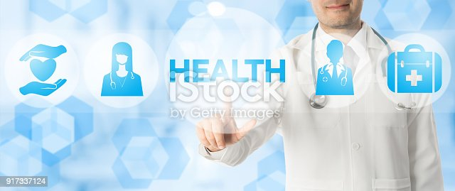 istock Doctor Points at HEALTH with Medical Icons 917337124