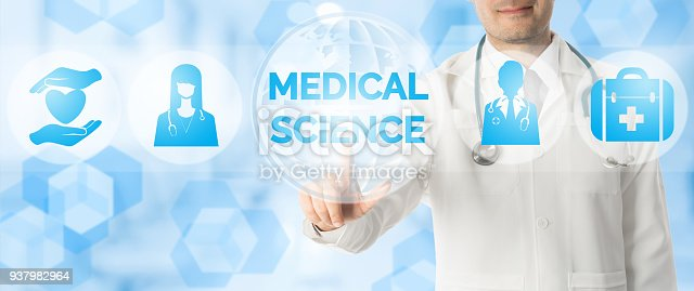 istock Doctor Points at MEDICAL SCIENCE with Medical Icon 937982964