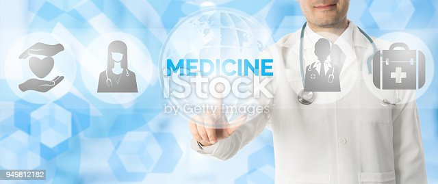 istock Doctor Points at MEDICINE with Medical Icons 949812182