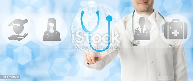 istock Doctor points at stethoscope with medical icons. 911749896