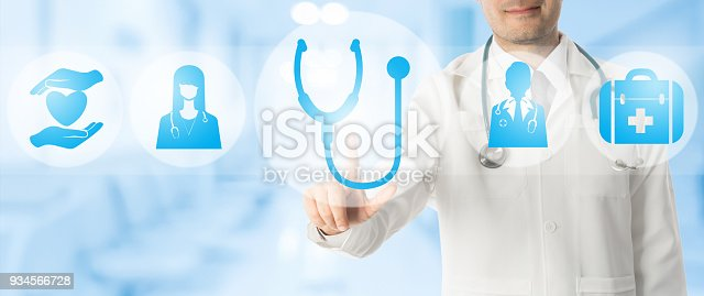 istock Doctor points at stethoscope with medical icons. 934566728