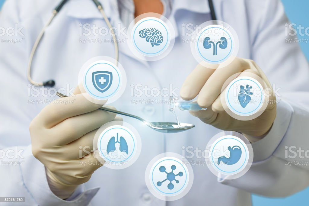 Doctor pours medicine for treatment . stock photo