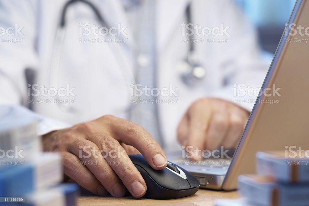 Doctor preparing online internet prescription stock photo