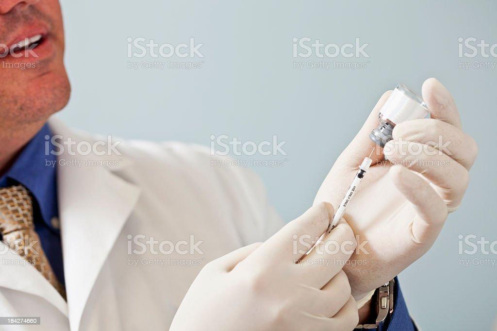 Doctor preparing syringe stock photo