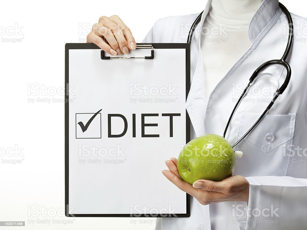 Doctor prescribing diet royalty-free stock photo