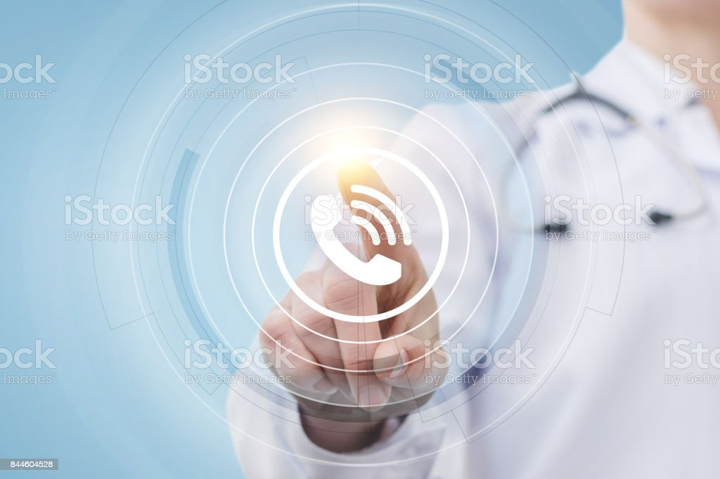 Doctor presses the call button. stock photo