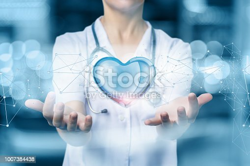 istock Doctor protects heart on blurred background. 1007384438
