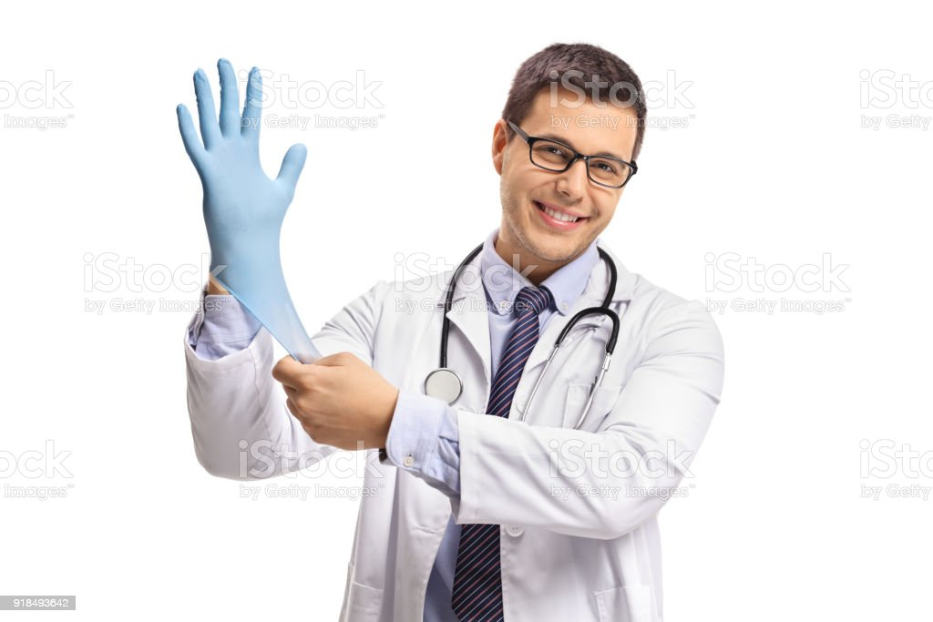Doctor putting on a medical glove stock photo