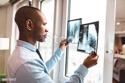 istock doctor reading the x-ray in the office 686773472