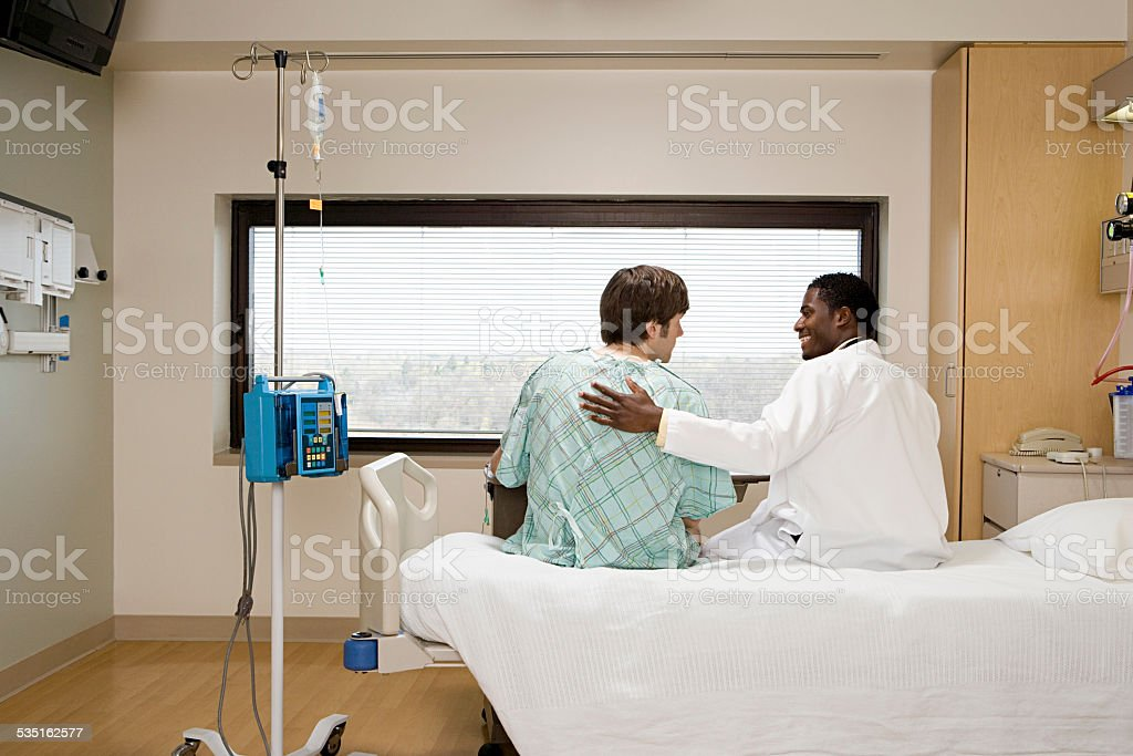 Doctor reassuring patient stock photo