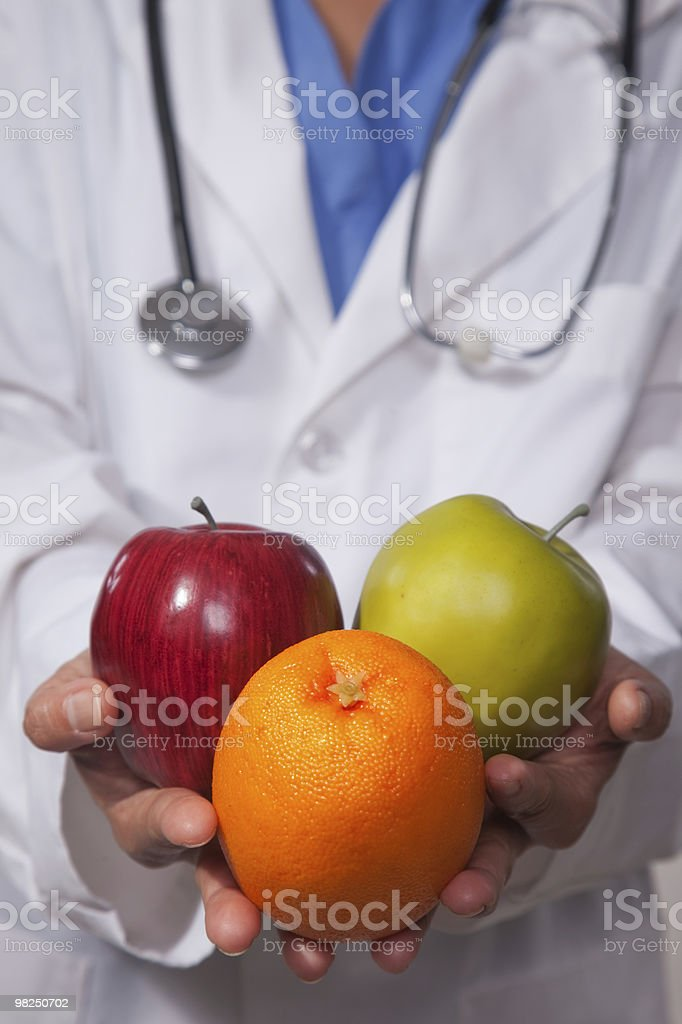 Doctor recommending healthy diet royalty-free stock photo